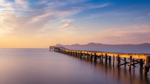 Wooden pier located on playa de muro beach, Alcudia. Sunrise