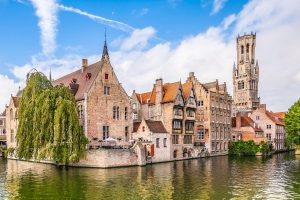 city view with Belfry tower and famous canal in Bruges, Belgium