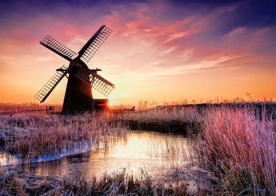Sunset over Windmill in Norfolk