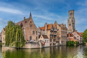 Bruges famous canal and Belfry tower